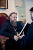 Orthodox liturgy with bishop Mercury in Moscow. MOSCOW - MARCH 13: The bishop Mercury reads the Gospel during Orthodox liturgy in High Monastery of St Peter in Stock Photo