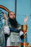 Orthodox liturgy ceremony. Voyutyn, Volyn / Ukraine - October 14 2008: Priest during orthodox liturgy ceremony stock photos