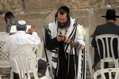Orthodox man prayers at Western wall of Jerusalem Stock Images