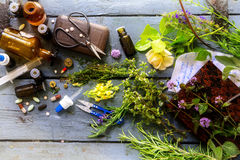 From orthodox medicine to natural medicine, from pills and drops to healing herbs with equipment on a rustic wooden table. From orthodox medicine to natural stock image