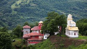 Orthodox monastery in the hills. With the church and inn for overnight stay stock footage