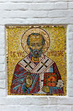 Orthodox mosaic icon on the church wall. Royalty Free Stock Images