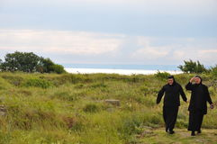 ORTHODOX NUNS AT BLACK SEA Stock Images