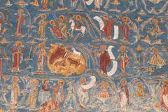 Orthodox painted church wall. Fragment of an exterior church wall, painted in the Orthodox (Eastern Christian) tradition, depicting the life of saints, with the stock image