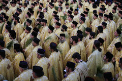 ORTHODOX PILGRIMAGE IN BUCHAREST. Romanian Orthodox priests gathered in front of Patriarchal Cathedral in Bucharest, Romania, during a Palm Sunday pilgrimage royalty free stock photo
