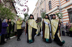 ORTHODOX PILGRIMAGE IN BUCHAREST. Romanian Orthodox priests gathered in front of Patriarchal Cathedral in Bucharest, Romania, during a Palm Sunday pilgrimage royalty free stock images