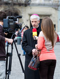 Orthodox priest. Giving an interview for a TV station during the protests against abortion on March 24, 2012 in Cluj-Napoca, Romania stock photo