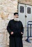 Orthodox priest. Orthodox Greek priest outside the Church of the Holy Sepulchre stock images