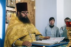 Orthodox priest in altar Stock Photography