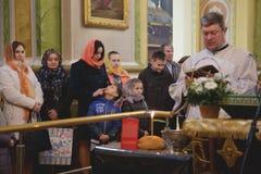 Orthodox priest and church parishioners Stock Photo