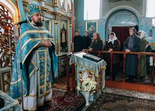 Orthodox priest and church parishioners Stock Photos