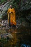 Orthodox priest during sacrament of spiritual birth - Baptism. Stock Photo