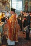 Orthodox priest sanctifies graduates. KIVERCI, UKRAINE - June 26, 2009: Orthodox priest sanctifies graduates in the church Stock Images