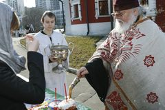 Orthodox priest spatter the holy water Stock Photography