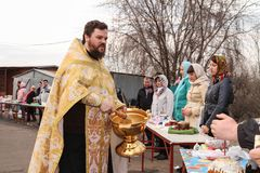 Orthodox priest spatter the holy water Royalty Free Stock Image