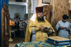 Orthodox priests in altar. VOYUTYN, Volyn / UKRAINE - OCTOBER 14 2017: Orthodox priest during celebration Pokrov royalty free stock photo