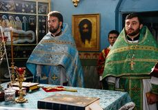 Orthodox priests in church Stock Images