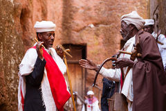 Orthodox priests greeting each other during Timkat festival at L. Two old friends greeting each other during Timkat festival at Lalibela in Ethiopia royalty free stock photography