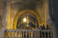 Orthodox priests and pilgrims in The Church of the Holy Sepulchre. Orthodox priests and pilgrims at the Easter midnight liturgy in The Church of the Holy stock photography