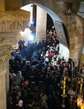 Orthodox priests and pilgrims in The Church of the Holy Sepulchre royalty free stock images