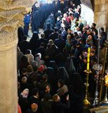 Orthodox priests and pilgrims in The Church of the Holy Sepulchre. Orthodox priests and pilgrims at the Easter midnight liturgy in The Church of the Holy royalty free stock photography