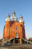 Orthodox red brick Church form outside Stock Image