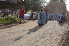 Orthodox religious procession in Melnikovo. Russia. Tomsk. Orthodox procession from the city of Tomsk, passes through the village of Melnikovo Royalty Free Stock Photography