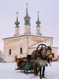 Orthodox Russia. The horsy and ancient church Royalty Free Stock Photography