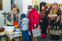 Orthodox service for the Baptism in the Kaluga region on 19 January 2016. Epiphany worship in the temples of Kaluga in Russia has solemnity and beauty. The stock photography