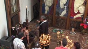Orthodox service in the church of St. Petka in Rupite, Bulgaria stock video footage