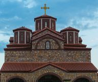 Orthodox Symmetric Church. Interesting symmetric construction in my town, the new Orthodox Church, dominated by the golden cross on top of the main minaret stock image