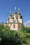 Orthodox temple on the background of blue sky. Royalty Free Stock Image