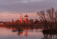 Orthodox temple on the banks of the river at sunset Royalty Free Stock Photos