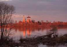 Orthodox temple on the banks of the river at sunset Royalty Free Stock Image