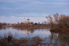 Orthodox temple on the banks of the river at sunset Royalty Free Stock Photography