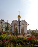 Orthodox temple buildings. Orthodox chapel and flower beds on the territory of an Orthodox Church Stock Photo