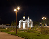 Orthodox temple buildings. Orthodox temple complex. Architectural lighting. Internal territory of the complex. Street lamp in classic style, chapel and bell Stock Photography