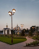 Orthodox temple buildings. Orthodox temple complex. Architectural lighting. Internal territory of the complex. Street lamp in classic style, chapel and bell Royalty Free Stock Images
