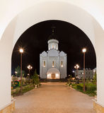 Orthodox temple buildings. Orthodox temple complex. View through the portal to the temple with evening architectural lighting Stock Image