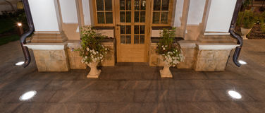 Orthodox temple buildings. Embedded in the granite pavement lights. Lighting of the sidewalk. A vase of flowers and the door to the chapel Stock Photos