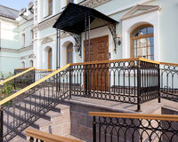 Orthodox temple buildings. The entrance of the refectory in luxury classic style. Stairs, railing, canopy Royalty Free Stock Photos