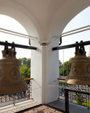Orthodox temple buildings. A fragment of the bell tower with built-in light. Bells Royalty Free Stock Images