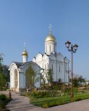 Orthodox temple buildings. Orthodox monastery. Church on the background of blue sky, chapel and street lamp Royalty Free Stock Images