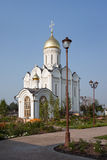 Orthodox temple buildings. Orthodox monastery. Church on the background of blue sky, chapel and street lamp Royalty Free Stock Image