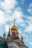 A Orthodox temple. Golden domes and crosses on the Orthodox temple Royalty Free Stock Photography