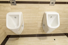 White mens urinals in the background toilet Royalty Free Stock Photos