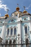 Orthodox temple of saint Alexander in Kharkiv Ukraine. Orthodox temple of saint Alexander in city Kharkiv Ukraine. Temple in a bright sunny summer day on a blue Stock Photo