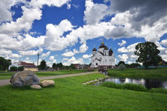 Orthodox Transfiguration Cathedral on the shore of river. Orthodox Transfiguration Cathedral on the shore of Oksna river in Smorgon, Belarus royalty free stock images