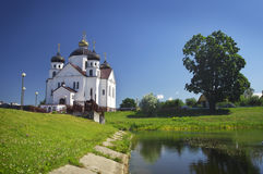 Orthodox Transfiguration Cathedral on the shore of river. Orthodox Transfiguration Cathedral on the shore of Oksna river in Smorgon, Belarus stock image