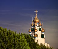 Orthodox type church at the end of the trees Stock Image